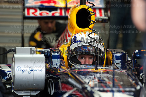 Red Bull Racing Formula One driver Sebastian Vettel of Germany sits in his car during the free practice during the Hungarian F1 Grand Prix in Mogyorod (about 20km north-east from Budapest), Hungary. Thursday, 28. July 2011. ATTILA VOLGYI