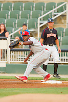 Lakewood BlueClaws first baseman William Carmona (23) stretches for a throw during the South Atlantic League game against the Kannapolis Intimidators at CMC-Northeast Stadium on August 14, 2013 in Kannapolis, North Carolina.  The Intimidators defeated the BlueClaws 10-2.  (Brian Westerholt/Four Seam Images)