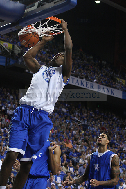 Center Dakari Johnson dunks the ball during the first half of the Blue-White Scrimmage at Rupp Arena on Monday, October 27, 2014 in Lexington, Ky. Photo by Adam Pennavaria | Staff