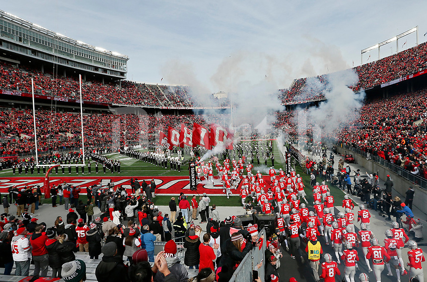 Ohio State Buckeyes players take the field prior to the NCAA football game against the Michigan State Spartans at Ohio Stadium in Columbus on Nov. 11, 2017. [Adam Cairns/Dispatch]