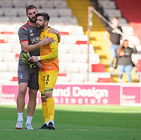 Lincoln City's first team coach Jamie McCombe, left, and Lincoln City's Josh Vickers at the end of the game<br /> <br /> Photographer Chris Vaughan/CameraSport<br /> <br /> The EFL Sky Bet League One - Lincoln City v Bristol Rovers - Saturday 14th September 2019 - Sincil Bank - Lincoln<br /> <br /> World Copyright © 2019 CameraSport. All rights reserved. 43 Linden Ave. Countesthorpe. Leicester. England. LE8 5PG - Tel: +44 (0) 116 277 4147 - admin@camerasport.com - www.camerasport.com