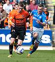 Dundee Utd's Ryan Gauld gets away from St Johnstone's Patrick Cregg.