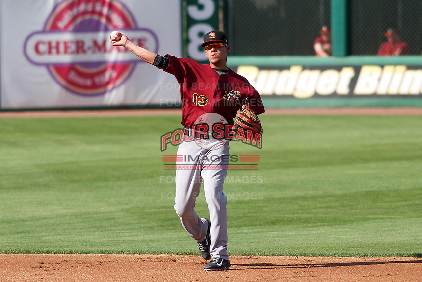 Quad Cities River Bandits infielder Kristian Trompiz (13) throws to first during a Midwest League game against the Wisconsin Timber Rattlers on July 17th, 2015 at Fox Cities Stadium in Appleton, Wisconsin. Quad Cities defeated Wisconsin 4-2. (Brad Krause/Four Seam Images)
