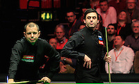 O'Sullivan looks on after a Hawkins miss during the Dafabet Masters FINAL between Barry Hawkins and Ronnie O'Sullivan at Alexandra Palace, London, England on 17 January 2016. Photo by Liam Smith / PRiME Media Images