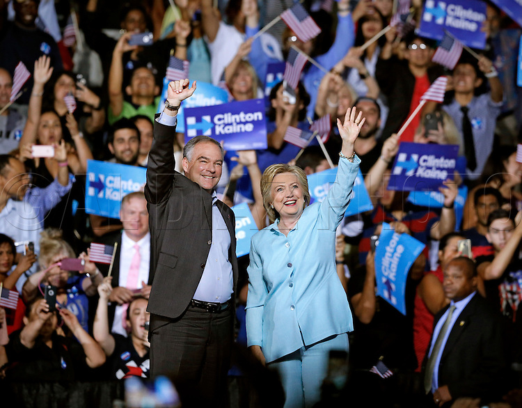 Hillary Clinton introduces Virginia Senator Tim Kaine as her vice presidential running mate at Florida International University on Saturday, July 23, 2016.