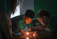 NWA Democrat-Gazette/CHARLIE KAIJO Nathan Milner (left) and Hayden Bahr (right) use a lighting device to demonstrate kinetic and potential energy during a STEM summer camp, Monday, June 10, 2019 at Bonnie Grimes Elementary School in Rogers.<br />