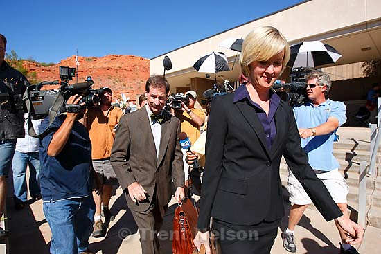 defense attorney Tara Isaacson, Walter Bugden and media. St. George - Warren Jeffs trial. The polygamous sect leader was charged with two counts of rape as an accomplice stemming from a marriage he officiated involving a 14-year-old girl and her 19-year-old cousin.