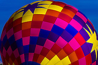 A colorful hot air balloon envelope (balloon is named Sunglow), Albuquerque International Balloon Fiesta, Albuquerque, New Mexico USA.