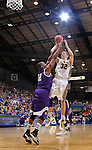 SIOUX FALLS, SD - MARCH 9:  Marcus Heemstra #32 of South Dakota State shoots over Michael Ochereobia #52 of Western Illinois during their first round game at the 2014 Summit League Basketball Championships Sunday at the Sioux Falls Arena.  (Photo by Dick Carlson/Inertia)