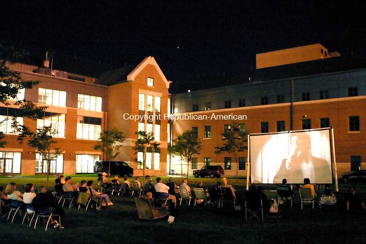 """AVON, CT- 29 JULY 2005-072905JS07--Residents enjoy the Woody Allen film """"Broadway Danny Rose"""" during the seond movie in the Downtown Merchants Association's outdoor film series Friday at the UConn campus courtyard in Waterbury. The third and final film in the series, """"Breakfast at Tiffany's,"""" is scheduled for August 12 at the UConn campus at 9:00 p.m.  -- Jim Shannon Photo--are CQ"""