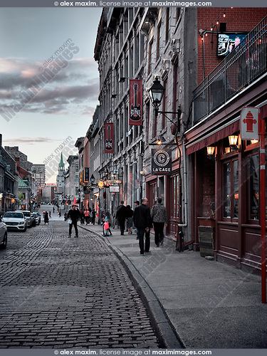 La Cage and other shops and restaurants on Rue St Paul historic street of old town in Montreal, Quebec, Canada in the evening. Rue Saint Paul Est, Ville de Montréal, Québec, Canada. 2017.
