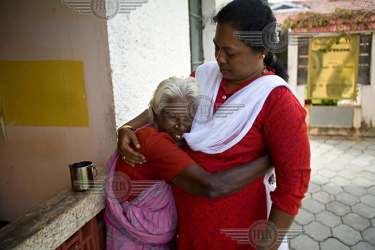 Parvati, an elderly resident, hugs the manager Amudha at the Tamaraikulum Elders' village. The village is a pioneering experiment initially set up by HelpAge India after the Asian Tsunami to help elderly people displaced by the natural disaster. Today, the village is a self-sustaining community providing a family environment where more able-bodied residents assist the less able-bodied and provides 100 older people with a safe place to live, free healthcare, emotional security, a good diet and professional care and support...
