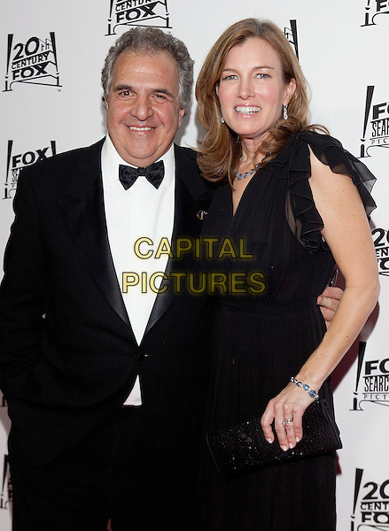 Jim Janopolis and Wife.2013 Twentieth Century Fox & Fox Searchlight Pictures Oscar Party held at  Lure, Hollywood, California, USA..February 24th, 2013.oscars half length black tuxedo dress married husband.CAP/ADM/DAN.©Dan Scott/AdMedia/Capital Pictures.