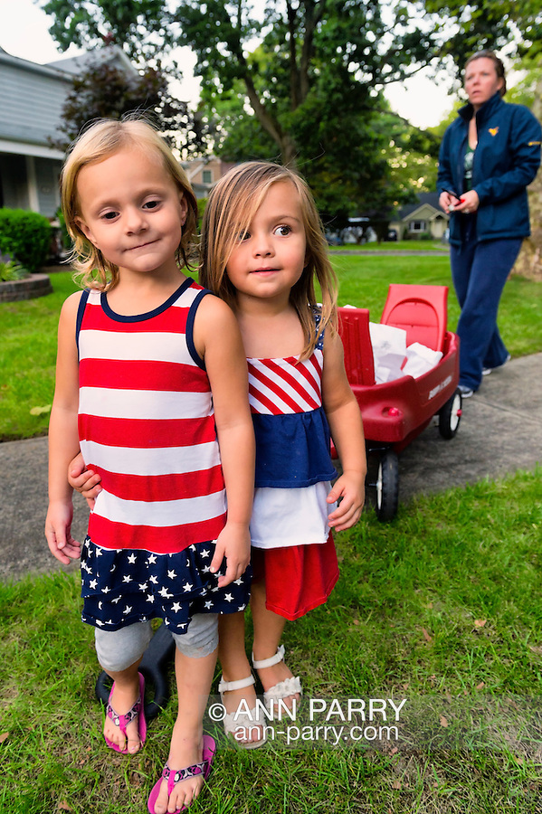 Sept. 11, 2012 - Merrick, New York, U.S. - (L-R) LYLA WILLIAMS, 3, KATE OLLENDIKE, 2, and MICHELLE BARRETT, all from Merrick, are helping to distribute 500 Luminary Bags among the 215 Wenshaw Park homes on the 11th Anniversary of 9/11, by Wenshaw Park Civic Association (WPCA), Long Island, with over $500 already raised for Twin Towers Orphan Fund.