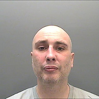 Pictured: Police custody handout of Jonathan Donne.<br /> Re: Jonathan Donne, a convicted killer who murdered 67 year old John 'Jack' Williams after robbing him in his own home has been jailed for life by Swansea Crown Court.<br /> Donne, 42, from Swansea, was found guilty of the robbery and murder.<br /> Mr Williams was tied up and battered in the living room of his Swansea home in March 2018 because Donne thought he had a large quantity of drugs and money.<br /> He was told he must serve at least 31 years before he can be released from prison.<br /> He was also given a 15 year sentence for robbery, which will be served concurrently.<br /> Donne went to Mr Williams's house because he needed money where he hit and tied Mr Williams up, but insisted he was alive when he left.<br /> Mr Williams suffered serious brain and head injuries in the attack.<br /> The victim had been growing and selling cannabis and Donne thought he would have drugs and cash he could steal.