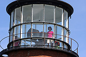 Aquinnah, MA - August 27, 2009 -- Malia Obama, 11, inside Gay Head Lighthouse, first used in 1799, in Aquinnah on Martha's Vineyard, Mass. Thursday, August 27, 2009. The Obama's visited the lighthouse with Obama's friend Eric Whitaker and his family after a bike ride in Aquinnah. .Credit: Vincent DeWitt - Pool via CNP