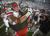 Ohio State Buckeyes defensive lineman Joey Bosa (97) celebrates OSU's overtime win with defensive coach Larry Johnson SR at Beaver Stadium on October 25, 2014.  (Chris Russell/Dispatch Photo)