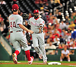 28 September 2010: Philadelphia Phillies' first baseman Ryan Howard makes a toss to pitcher Roy Oswalt covering first during a game against the Washington Nationals at Nationals Park in Washington, DC. The Nationals defeated the Phillies 2-1 on an Adam Dunn walk-off solo homer in the 9th inning to even up their 3-game series one game apiece. Mandatory Credit: Ed Wolfstein Photo