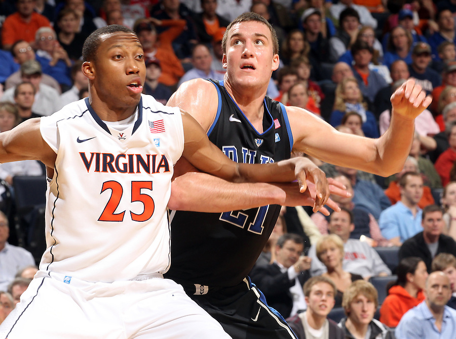Feb. 16, 2011; Charlottesville, VA, USA; Duke Blue Devils forward Miles Plumlee (21) looks for the rebound next to Virginia Cavaliers forward Akil Mitchell (25) during the second half of the game at the John Paul Jones Arena. The Duke Blue Devils won 56-41.  Credit Image: © Andrew Shurtleff
