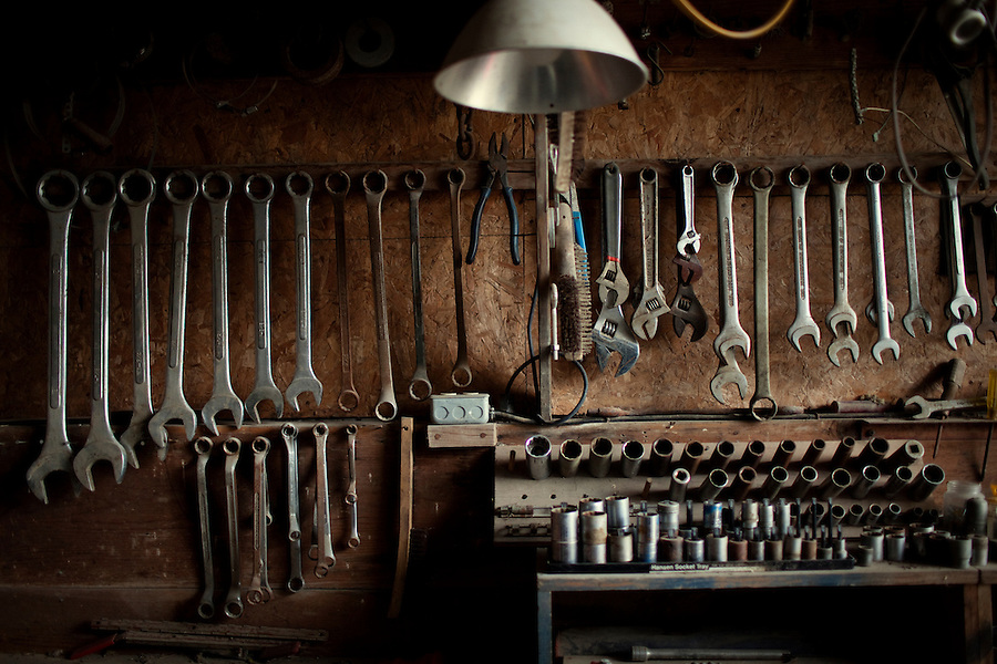 Wellsville, Kansas, May 28, 2011 -  A wall of tools line one of the many tool sheds of fourth generation family farmer Robin Dunn at her farm, Dunn's Landing..She bought her great grandparents homestead from her father in 1993, and today grows soybeans, corn, sorghum and hay, and maintains a small herd of Black Angus cattle and eight horses which she uses to for wagon and stage coach rides.  According to the most recent Department of Agriculture data, there are more than 306,000 farms run primarily by women in 2007, representing about 14 percent out of the 3.3 million American farms.  That's up from 237,819 or 11 percent in 2002, and a big increase from the 1980s when about five percent of U.S. farms were operated by women.Dunn has branched out from her farming business, using her century-old dairy barn to host 25 to 30 weddings and other events a year. She also attracts tourists for farm tours and carriage rides, and holds sessions with school children to teach them about faming.
