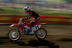Travis Preston (11) competes on the course at the Unadilla Valley Sports Center in New Berlin, New York on July 16, 2006, during the AMA Toyota Motocross Championship.