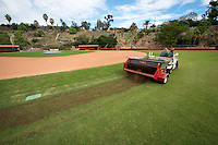 """Facilities staffers Jesse Montanez and Russ Jirel spread what used to be part of the Dodgers Stadium outfield onto the upper and lower soccer fields and part of Anderson Field on Wednesday. Ruben Campos, Oxy's assistant director of maintenance, knows the Dodgers' head groundskeeper and jumped at an offer to use the shredded combination of sod, soil and sand as a top dressing for the fields. (The stadium grass needed to be replaced after AC/DC's Sept. 28 concert.) """"It was so rich, it starting growing grass in the parking lot,"""" said Campos. """"And it was free.""""<br /> (Photo by Marc Campos, Occidental College Photographer)"""
