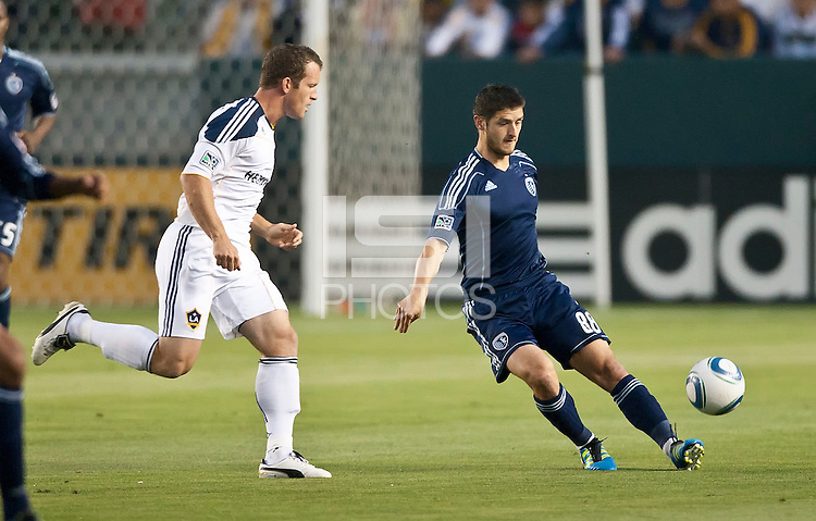 CARSON, CA – May 14, 2011: Sporting KC midfielder Milos Stojcev (88) makes a pass during the match between LA Galaxy and Sporting Kansas City at the Home Depot Center in Carson, California. Final score LA Galaxy 4, Sporting Kansas City 1.