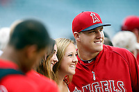 Mike Trout #27 of the Los Angeles Angels poses for a photo with some fan's before a game against the St. Louis Cardinals at Angel Stadium on July 3, 2013 in Anaheim, California. (Larry Goren/Four Seam Images)