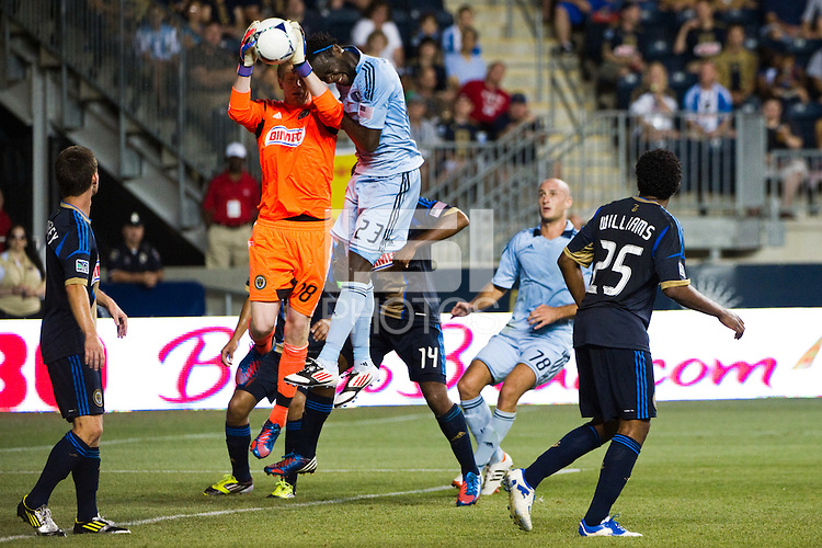 Philadelphia Union goalkeeper Zac MacMath (18) grabs a pass intended for Kei Kamara (23) of Sporting Kansas City. Sporting Kansas City defeated the Philadelphia Union 2-0 during the semifinals of the 2012 Lamar Hunt US Open Cup at PPL Park in Chester, PA, on July 11, 2012.