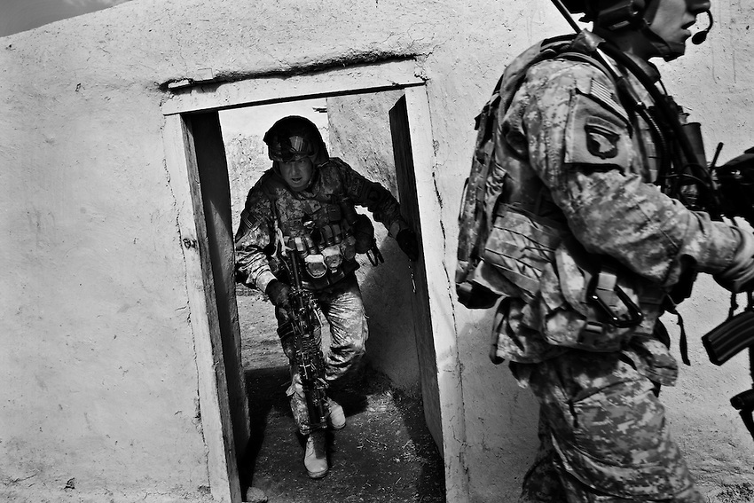 Sgt. Jamie Gassett (L) and Lt. James Mis search a stable in a suspected Taliban commander's home during an operation conducted by members of Baker Company, 1/506th Infantry and Afghan security forces in the village of Marzak, Paktika Province, Afghanistan, Thursday, Feb. 26, 2009.