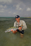 BARRY BECK WITH A BONEFISH CAUGHT FLY FISHING