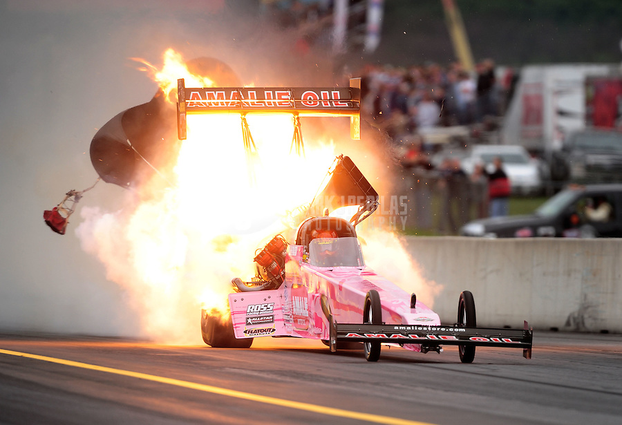 Oct. 1, 2011; Mohnton, PA, USA: NHRA top fuel dragster driver Terry McMillen explodes an engine in flames during qualifying for the Auto Plus Nationals at Maple Grove Raceway. Mandatory Credit: Mark J. Rebilas-
