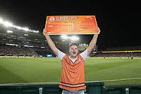 Mitchell Grimstone celebrates getting the $50'000 dollar catch a million cheque after taking a one handed catch in the crowd  during the Black Caps v Australia international T20 cricket match at Eden Park in Auckland, New Zealand. 16 February 2018. Copyright Image: Peter Meecham / www.photosport.nz