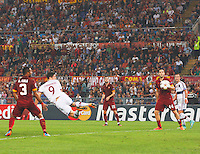 Bayer's Robert Lewandowskin shoots and scores during the Champions League Group E soccer match between As Roma and FC Bayern Munchen at the Olympic Stadium in Rome october 21 , 2014.