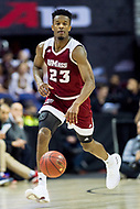 Washington, DC - MAR 7, 2018: Massachusetts Minutemen guard C.J. Anderson (23) brings the ball up court in game between La Salle and UMass during first round action of the Atlantic 10 Basketball Tournament at the Capital One Arena in Washington, DC. (Photo by Phil Peters/Media Images International)