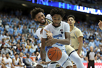 CHAPEL HILL, NC - JANUARY 4: Leaky Black #1 of the University of North Carolina and James Banks III #1 of Georgia Tech fight for a rebound during a game between Georgia Tech and North Carolina at Dean E. Smith Center on January 4, 2020 in Chapel Hill, North Carolina.