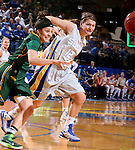 BROOKINGS, SD - JANUARY 31:  Macy Miller #12 from South Dakota State University battles for the loose ball with Brooke LeMar #4 from North Dakota State University in the first half of their game Saturday afternoon at Frost Arena in Brookings. (Photo by Dave Eggen/Inertia)