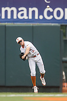 Texas Longhorns outfielder Collin Shaw #4 makes a throw from the outfield during the NCAA baseball game against the Oklahoma State Cowboys on April 26, 2014 at UFCU Disch–Falk Field in Austin, Texas. The Cowboys defeated the Longhorns 2-1. (Andrew Woolley/Four Seam Images)