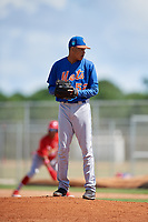 GCL Mets relief pitcher Yadiel Flores (52) gets ready to deliver a pitch during a game against the GCL Cardinals on August 6, 2018 at Roger Dean Chevrolet Stadium in Jupiter, Florida.  GCL Cardinals defeated GCL Mets 6-3.  (Mike Janes/Four Seam Images)