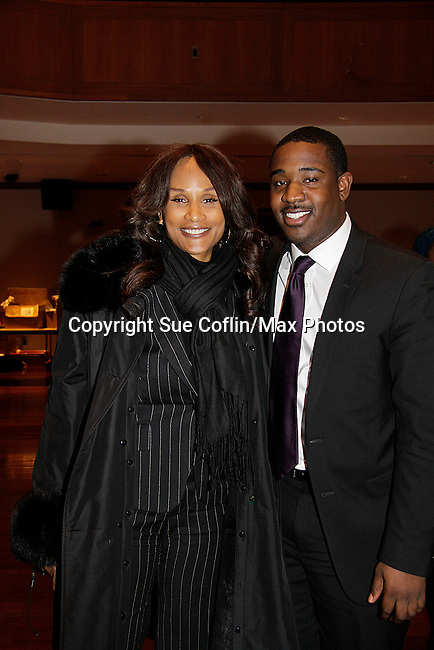 John is the newphew of Beverly and poses with Super model Beverly Johnson is a panelist at Color of Beauty recognizes stylish people of color with a one-day event featuring topical panel discussions followed later tonght with a red carpet awards ceremony. The event was on February 4, 2014 at New York University, New York City, NY. (Photo by Sue Coflin/Max Photos)