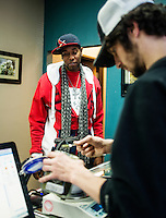 Eric Farthing (cq, right), weighs marijuana for Ali Williams (cq) at the Medicine Man grow house and dispensary in Denver, Colorado, Tuesday, March 5, 2013. With Colorado's Amendment 64, the state has been working to decide how it will transition to legalized marijuana in the state...Photo by Matt Nager