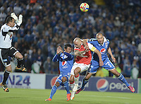 BOGOTÁ -COLOMBIA, 31-08-2014. Andres Cadavid (Der) jugador de Millonarios disputa el balón con Omar Perez (C) jugador de Independiente Santa Fe durante partido por la fecha 7 de la Liga Postobón II 2014 jugado en el estadio Nemesio Camacho el Campín de la ciudad de Bogotá./ Andres Cadavid (R) player of Millonarios fights for the ball with Omar Perez (C) player of Independiente Santa Fe during the match for the 7th date of the Postobon League II 2014 played at Nemesio Camacho El Campin stadium in Bogotá city. Photo: VizzorImage/ Gabriel Aponte / Staff