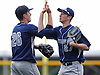 St. Dominic starting pitcher No. 26 Reiss Knehr, left, celebrates with centerfielder No. 27 John LaRocca after their team's 3-2 win over St. John the Baptist in Game 1 of a best-of-three NSCHSAA varsity baseball semifinals at New York Institute of Technology on Monday, May 18, 2015. LaRocca preserved St. Dominic's lead when threw out a runner at home for the final out of the bottom of the sixth inning.<br /> <br /> James Escher