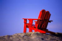 Adirondak chairs on rocky outlook.