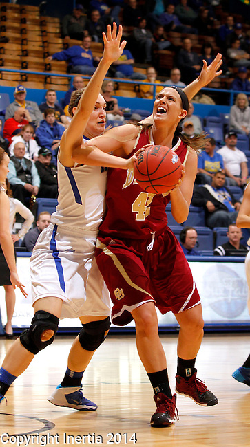 SIOUX FALLS, SD - MARCH 9:  Alison Janecek #42 from Denver  eyes the basket against the defense of Rebecca Bruner #34 from IPFW in the second half of their game Sunday afternoon at the 2014 Summit League Basketball Tournament in Sioux Falls, SD. (Photo by Dave Eggen/Inertia)