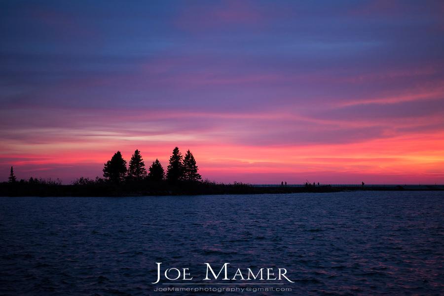 Sunset over Grand Marais breakwater.