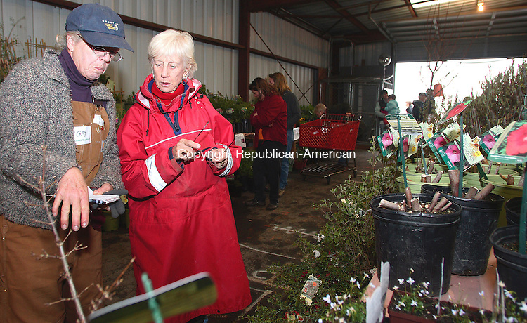 GOSHEN, CT-27 April 2007-042707MK02 (from left) Conservatrion District volunteer Gay Tucker talks with Jo Carpenter about various plants at the Northwest Conservation District's 25th annual Earth Day Plant sale at the Goshen Fair Grounds.  The event which runs today from 9 a.m. to 4 p.m. and tomorrow from 9 a.m. to 3 p.m. is a major fund raiser for the Conservation District.  Purchases provide funding for local conservation projects and education in addition to helping to curb climate change by planting items that absorb greenhouse gas pollution.   Michael Kabelka / Republican-American((from left) Conservatrion District volunteer Gay Tucker talks with Jo Carpenter) CQ