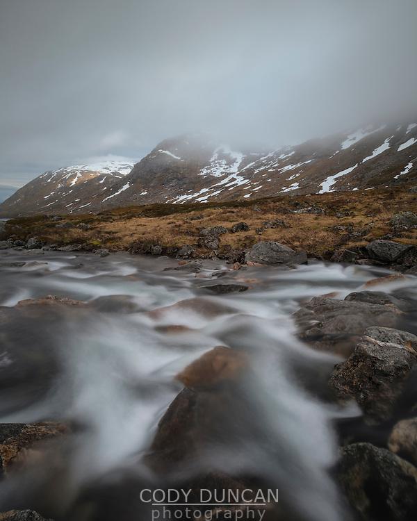 Kaperelva river flows through mountains, Senja, Norway