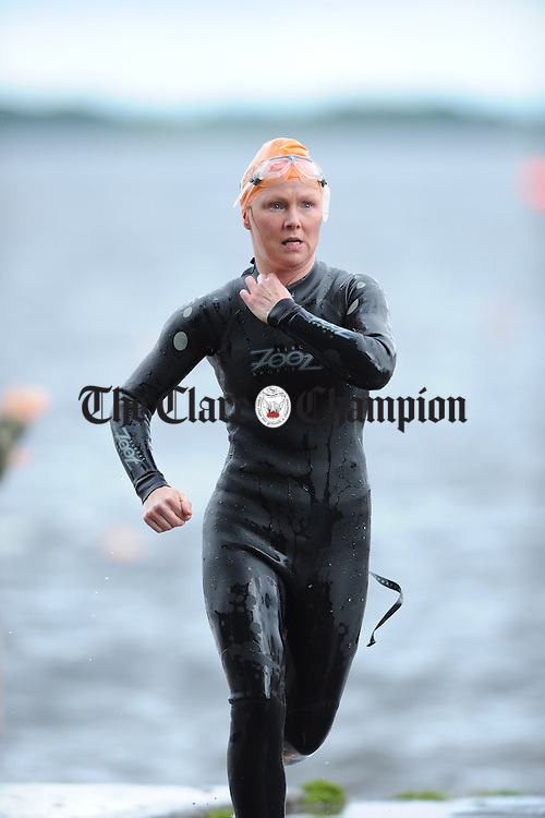 Exiting the water of Lough Derg after completing the 750m swim during the Brian Boru Sprint Triathlon at Two-Mile-Gate,  Killaloe. Photograph by John Kelly..