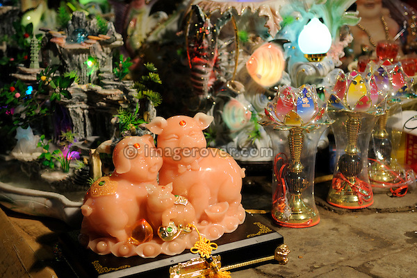 Asia, Vietnam, Hanoi. Hanoi old quarter. Happy pigs in shop decoration.